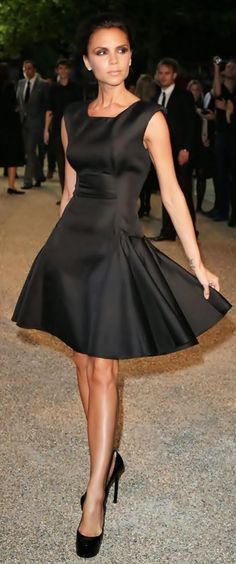 Victoria Beckham wearing beautiful little black dress (=)