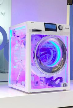Futuristic Appliances: Transparent Washing Machine Like this.