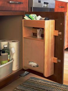 Undersink Ace Undersink Ace Affix a storage-packed caddy to the inside of a kitchen cabinet door to create a cleaning command center. Fill the lower chamber of the caddy with plastic bags, and keep frequently used scrubbing tools on the top shelf for easy access. A plastic bin placed in the cabinet interior corrals bottles of cleaning agents.