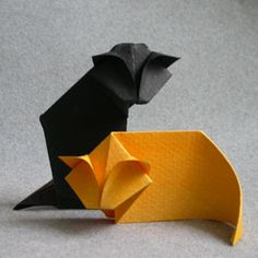Simple Origami Cat from sheet (for a successful outcome use damp heavy folding paper that is small / a watercolor paper that has been misted works well) Origami Design, Origami Ball, Gato Origami, Instruções Origami, Origami And Kirigami, Paper Crafts Origami, Useful Origami, Origami Flowers, Simple Origami