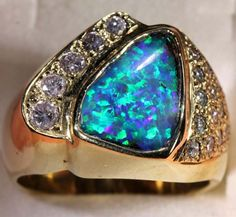 http://www.opalauctions.com/auctions/opal-rings/boulder-opal-gold-rings/item-472294