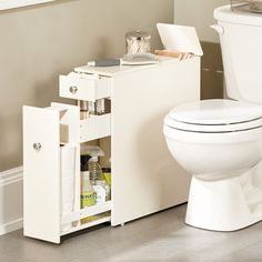 This narrow, stylized bath cabinet is thin enough to fit in that small space between the toilet and the wall, and it offers loads of storage options: a slide-out compartment for toilet paper and cleaning supplies, a flip-up top, and a top drawer with adjustable dividers.
