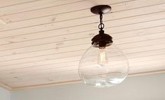 """A small space with a BIG IMPACT   Sarah Richardson Design  Lowe's Allen + Roth Pendant light 12"""" Bronze with clear shade Item # 198671"""