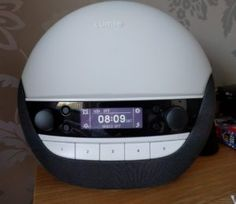 A Review of the Lumie Luxe 700 Bodyclock  As you know we are big fans of Lumie here. I have been using the Bodyclock Iris for quite some time and husb has been using the Active 250 for longer. When we found out about the new Lumie Luxe 700 we couldnt wait to try it out.  The Lumie Luxe 700 Now in quick terms the Luxe does everything all the other bodyclocks does but without the aromatherapy function of the Iris but improving the music function of the Active 250 by adding Bluetooth Speakers…
