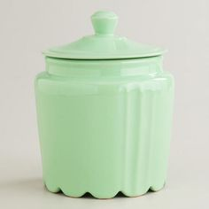 Mint Scalloped Jar at Cost Plus World Market - added to bookcase next to the TV with a teacup and saucer next to it.