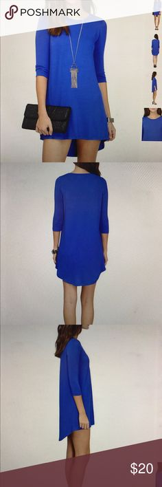 "'In Tunic With The Times' Dress Rayon and spandex. Front length 29"". Back length 33"". Sleeve length 17.5"". Tobi Dresses"