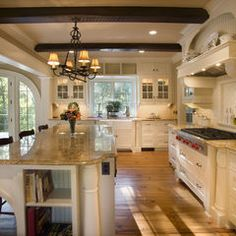 I really like this kitchen -- lighter colored cabinetry (though perhaps not as white as this), light granite countertops, and an island without cooktop or sink.  I like the sink over by the window -- that way, if there's a dish draining rack, it wouldn't look very nice on a beautiful island! Murphy & Co. Design