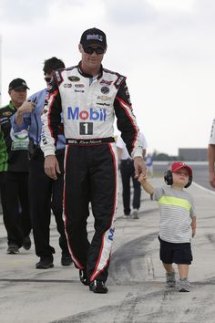 Kevin Harvick and son Keelan make their way down the grid before the start of the GoBowling.com 400 at Pocono Raceway. View more photos from Pocono here: http://www.stewarthaasracing.com/media/gallery/index.php