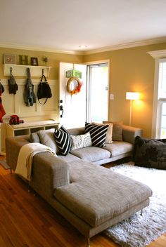 Front door opens into living area. I already have a couch just like this one and I love the open coat closet type of area.
