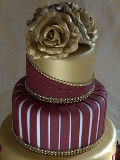 weddings in burgandy and gold | in gold and burgundy wedding cake with ruffles and roses in album ...