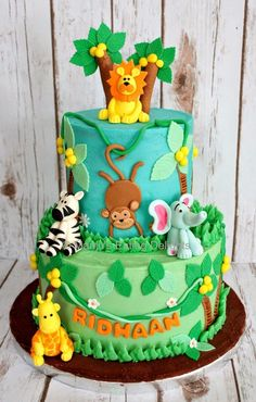 Jungle Animals themed Cake...White Velvet Cake with Mango Mousse filling and Vanilla buttercream frosting   Manju's Eating Delights