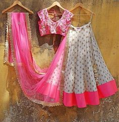 Offwhite butti Georgette lehenga with pink colour block.Teamed with a pink raw silk blouse with pearl, cut daana and zardosi embroidery. Pink Dupatta in soft net has zardosi embroidery and a gorgeous gold border. Kids Lehenga Choli, Half Saree Lehenga, Lehnga Dress, Pink Lehenga, Indian Lehenga, Bridal Lehenga, Half Saree Designs, Lehenga Designs, Choli Designs
