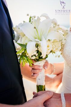 White rose, oriental lily and baby's breath bouquet
