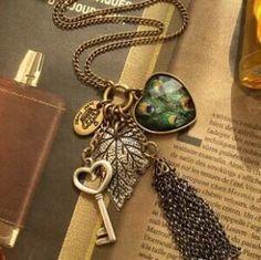 fashion Europe peacock feather leaves big heart keys tassel multi-element vintage long necklace