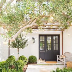 When we planted these olives I had to fight the installers to keep this low hanging branch. I love how it frames the entrance and beckons you to my front door (at least until the ill-behaved dogs hear Tuscan Design, Tuscan Style, Interior Exterior, Exterior Design, Mansion Interior, Outdoor Spaces, Outdoor Living, Haus Am Hang, Fire Pit Landscaping