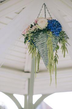 Blue wedding inspiration. A hanging blue flower arrangement.  For more inspiration visit www.weddingsite.co.uk