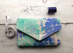 Canvas bag with painted abstract design/boho chic envelope clutch with watercolor design by MyALaModeBoutique on Etsy https://www.etsy.com/listing/166656483/canvas-bag-with-painted-abstract