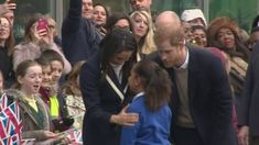 This is the adorable moment Prince Harry brings Sophia to talk to his fiancee Meghan Markle during a visit to a school in Birmingham after she told him she wanted to be an actress,