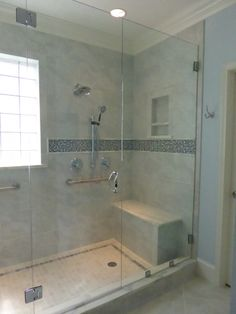 spa style master bath shower with bench seating, heated floors, glass mosaic tile detail and frameless glass enclosure by Bhe Design LLC