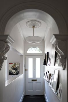 hallway picture wall   on ledges-shelves; Anna Carin Design