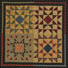 """On this 44""""-square quilt, a black print frames a quartet of blocks. All fabrics are from Kim Diehl's Country Haven collection for Henry Glass & Co."""