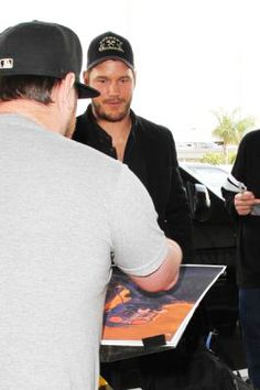 Chris Pratt is surrounded by autograph-seekers and photographers when he arrives at LAX for an outbound flight. - Saturday, September 17, 2016