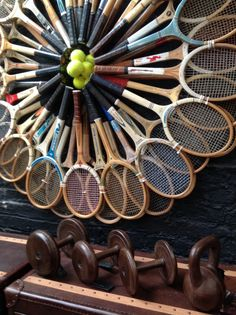 Antique tennis rackets that make up a striking wall feature at Stocktons furniture store manchester uk