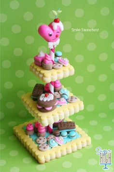Cookie Tower by Sugar High, Inc. (Cookie Stand tutorial by Bakerella: http://www.flickr.com/photos/bakerella/8423086198/)