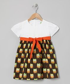 This pretty dress brings contemporary charm to any cutie's closet by combining a timeless print with a simple sash tie at the waist. Made from crisp cotton, it pulls on easily thanks to the buttons in back.