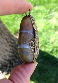 I fell in love with the look of real stones wrapped in bamboo, so I interpreted them into my work. These are my handmade glass stones with wire Wire Wrapped Jewelry, Wire Jewelry, Jewelry Crafts, Jewelry Art, Handmade Jewelry, Jewelry Design, Wire Necklace, Necklaces, Jewellery