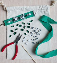 Go to town arranging loose rhinestones in any pattern you choose atop a piece of cotton ribbon.