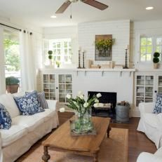 Contemporary Living Room Space With White Slipcovered Furniture I like the fireplace and built-ins