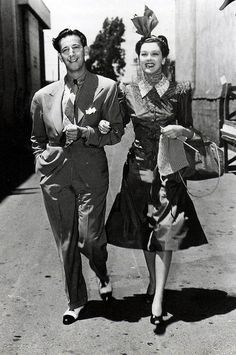"""Adrian and Rosalind Russell take a stroll. Rosalind Russell is wearing Adrian's perfect design for her character in the film """"The Women"""", 1939"""
