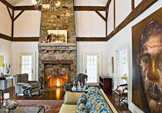 Beautiful Rustic Fireplace with Large Art Piece