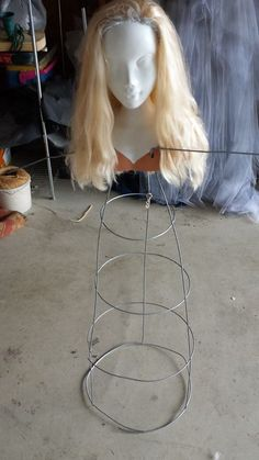 An old doll head or mask and a tomato cage...add a creepy night gown and you have a great prop. Add a light underneath the gown to add an eerie glow.