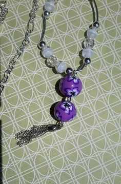 Check out this item in my Etsy shop https://www.etsy.com/listing/540913085/lavender-bohemian-flower-beaded-pendant