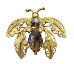 Spread your wings and show off fluttering elegance with a vintage Kramer butterfly brooch with rhinestone accents.