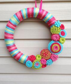 Spring Wreath - Multi-Color Spring Yarn Wreath w/ Felt Flowers. Yarn Wreath - Summer Wreath - Spring Decoration - Felt Flower Wreath by stringnthings on Etsy https://www.etsy.com/listing/187327649/spring-wreath-multi-color-spring-yarn