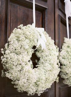 entry or altar backdrop.  Baby's breath wreaths.