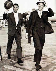 Dean Martin and Frank Sinatra make their way across  the London Airport  tarmac before travelling to Shepperton Studios to film a two minute cameo in the Bing Crosby and Bob Hope's comedy, 'Road to Hong Kong' - 4 August 1961