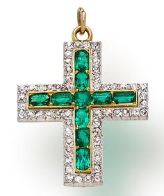 An antique emerald and diamond cross pendant, circa 1915 set with cushion-cut emeralds, within an old-cut diamond frame; estimated total diamond weight: 1.10 carats; mounted in eighteen karat gold and platinum.; length: 1 1/8in.