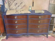 Refinished dresser. with teal, and a brown stained top