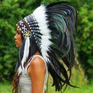 This amazing Indian war bonnet was handcrafted using real leather and 130cm slick rasta-style mixed feathers. View this and more Indian headdresses today!