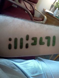 "Interesting forearm tattoo (it spells out ""ATHEIST"" in the negative spaces)"