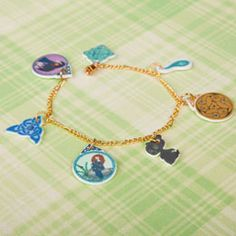 Every princess needs her signature accessories, so treat your own princess-in-training to her very own bracelet or necklace featuring Brave character charms