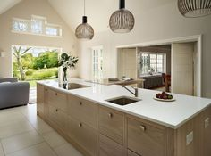 The black Octo 4240 -pendants by Secto Design creating a warm atmosphere to this sympathetic extension to an Arts & Crafts house, a contemporary Teddy Edwards family kitchen in the UK.