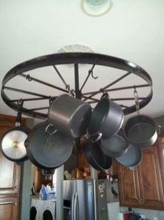 Pot rack from old wagon wheel. Wagon Wheel Decor, Farmhouse Style, Farmhouse Decor, Pan Hanger, Fancy Kitchens, Old Wagons, Western Decor, Country Decor, Kitchen Decor