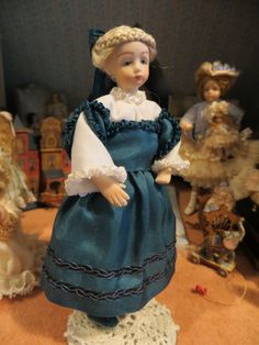 Connie Suave, The China Doll, IGMA fellow - blonde Dutch girl made of porcelain; sold on ebay for $99.99