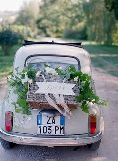 wedding getaway car - photo by Stefanie Kapra Photography http://ruffledblog.com/elegant-wedding-inspiration-in-tuscany #weddingideas