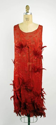 """JOSEPHINE BAKER"" dress  Attributed to House of Drécoll     Date:      1926  Culture: French  Medium: silk, glass beads, feathers  Dimensions: [no dimensions available]  Credit Line: Gift of Mrs. Mildred Orrick, 1940  Accession Number: C.I.40.169a. Metropolitan Museum of Art"